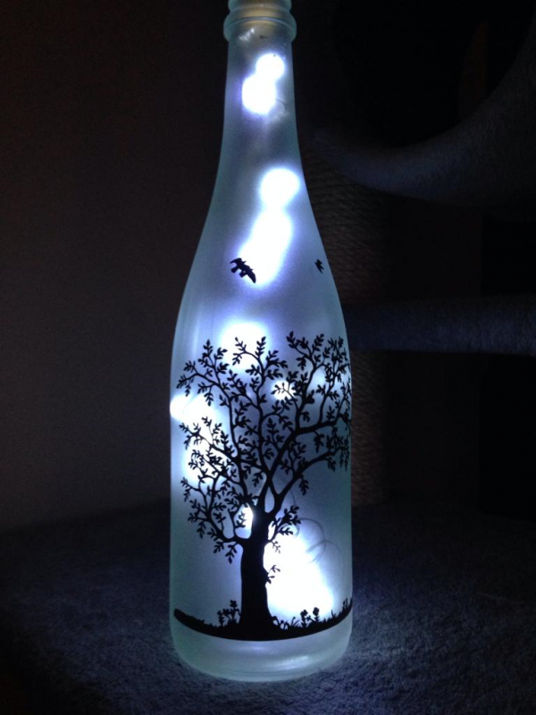 alt=upcycled-lighted-bottles-nature
