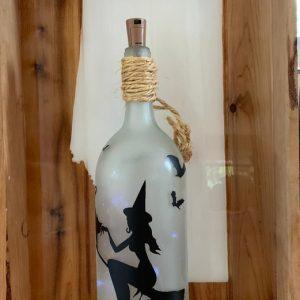 alt=upcycled-lighted-bottles-halloween